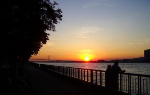 Sunset Over Detroit River from Windsor, ON, Canada by JessicaDobbs