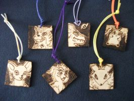 Digimon Pyrography Pendants by weisewoelfin