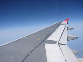 Airplane Wing in the Sky by FantasyStock