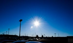 The sun and a parking lot. by Naqphotos