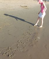 Benio: Writing in the sand by InuKid