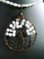 Howlite round leaves in bronze circle and bark by BacktoEarthCreations
