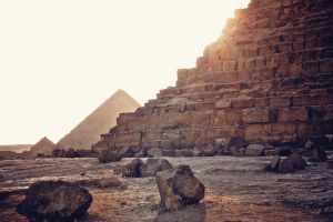 standing next to pyramids at sunset by 8moments