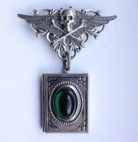 Skull locked book pendant by Pinkabsinthe
