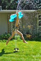Sprinkler Jump by heathersfeathers