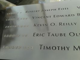South Tower's memorial pool. Names of the brave by JAIJ47
