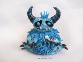 Little Fuzz Puff with bone Sculpture by NadilynBeato