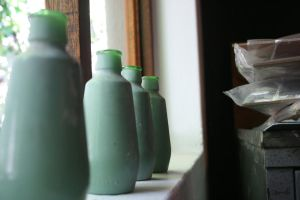 4 Green bottles sitting on the wall by EveMisterunderstood