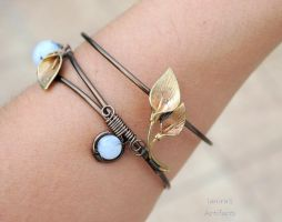 Wire bracelet cuff with moonstone and brass lilies by IanirasArtifacts