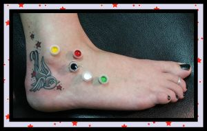 Foot Tattoo by madtattooz