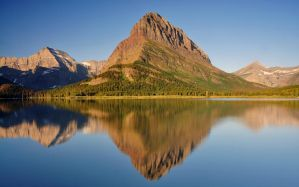 Grinnell Point and Swiftcurrent Lake by greglief