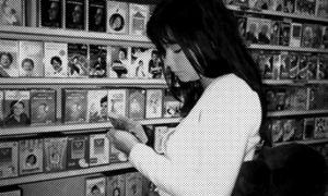 Bjork Looking at CDs by tacoboy101