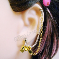 Silver and Gold Bow Connecting Chain Earring by merigreenleaf