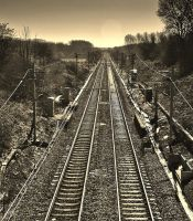 Train tracks perspective in sepia by StooMathiesen