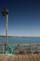 Lamp Post and Bikes on Pier by happeningstock