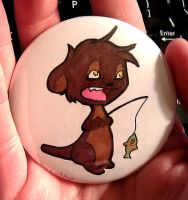 Otter with a fish - button by dragontrap