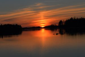Sunset over a lake by Antza2