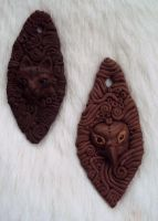 Cat and Falcon pendants by Ermelyn