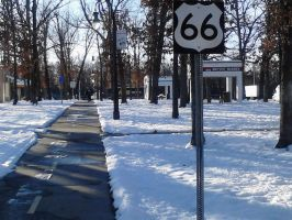 Sidewalk with 66 sign by Highwayhoss