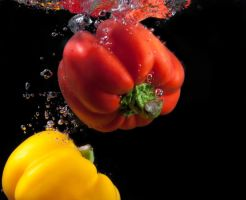 Red and yellow paprika. by Eevl