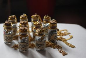 Steampunk Alchemical powder vial necklaces by ashblackthorn
