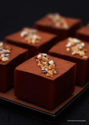 Coffee Cheesecake Blocks Topped with Hazelnuts by theresahelmer