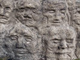 Stone faces by Inilein