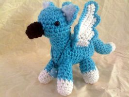 Turquoise and White Gryphon by hollyann