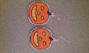 Pumpkin cross stitch earrings by moonprincessluna