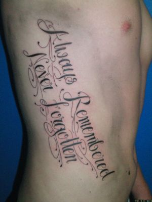 quote tattoos on rib cage for girls. tattoo quotes for girls on