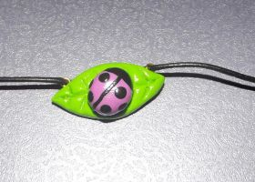 Pink ladybird necklace by MeticulousBlue