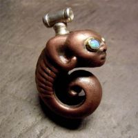 coiled creature pendant by morpho2012
