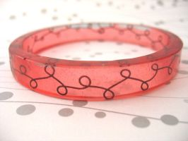 Bronze wire scroll pink bangle by TopazTurtle