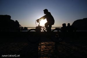Bicycle, Sunset and Lovers by ganara
