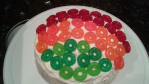 A white cake with Life Savers Gummies by mylesterlucky7