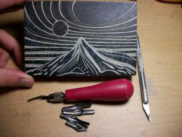 Linoleum block carving, Sun and Mountain design. by VibrantVoid
