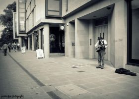 the lonely busker. by jorance