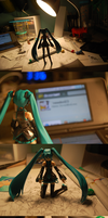Miku Explores My Desk by mewdool23