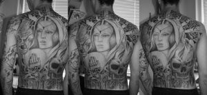 back tattoo by Unibody