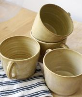 Four yellow mugs by scarlet1800