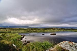 Clouds over the ridge and small lake, Tuva, Russia by murosvur