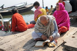 Reading by the Ganges (Varanasi, India) by drewhoshkiw