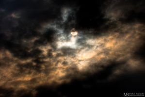 Morning sun behind clouds by Yupa