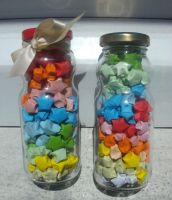 Bottles of origami stars by SophieEkard