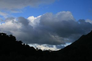 clouds through the mountains by snaplilly