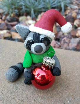Raccoon with glass ornament: Sold by ohara916