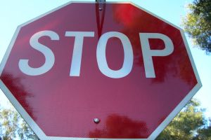 Shiny Stop Sign, upward view by paintresseye