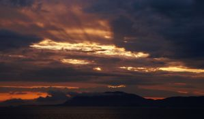 Cloudy Alaskan Sunset by pdelariva