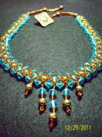 Brass and Teal Necklace by unshelvedgeek