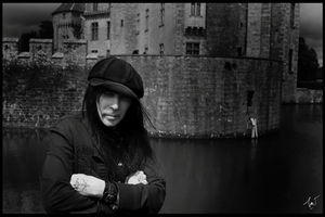 Mick infront of a castle by Durah